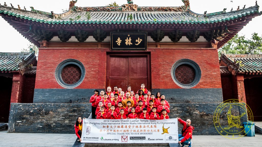 Team Canada proudly displaying sponsors in front of Shaolin Temple in 2014